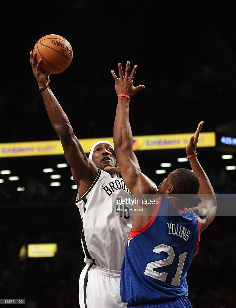 Gerald Wallace #45 of the Brooklyn Nets takes the shot against the Philadelphia 76ers at Barclays Center on December 23, 2012 in the Brooklyn borough of New York City.