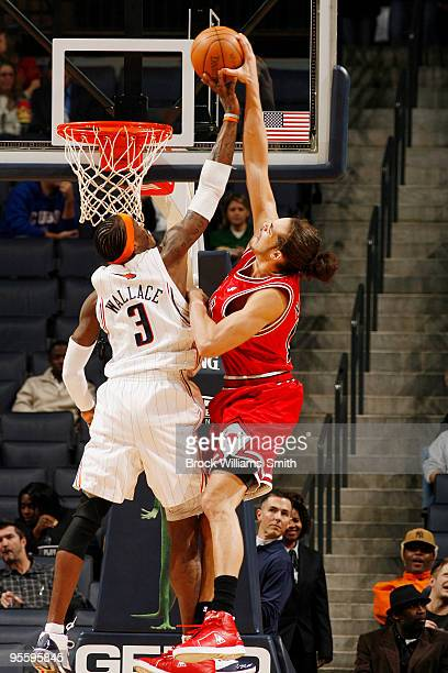 Gerald Wallace of the Charlotte Bobcats blocks a shot by Joakim Noah of the Chicago Bulls on January 5 2010 at the Time Warner Cable Arena in...