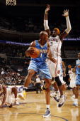 Gerald Wallace of the Charlotte Bobcats defends against Chauncey Billups of the Denver Nuggets on December 8 2009 at the Time Warner Cable Arena in...