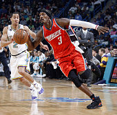 Gerald Wallace of the Charlotte Bobcats drives past Jannero Pargo of the New Orleans Hornets at the New Orleans Arena January 18 2008 in New Orleans...