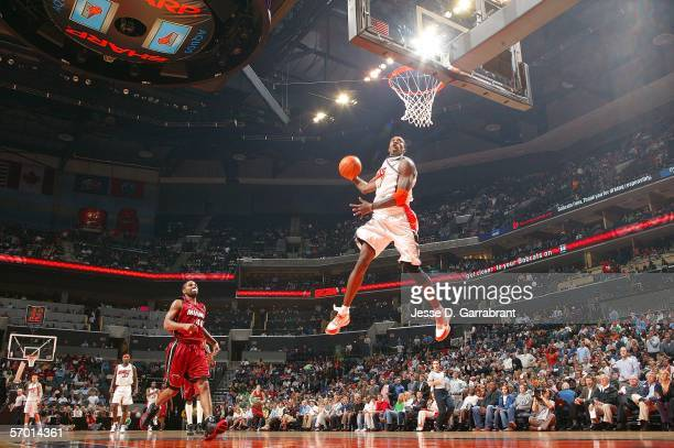 Gerald Wallace of the Charlotte Bobcats dunks against the Miami Heat at the Charlotte Bobcats Arena on March 6 2006 in Charlotte North Carolina NOTE...