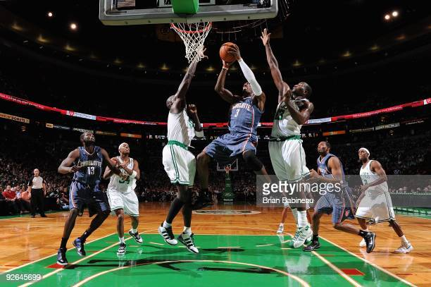 Gerald Wallace of the Charlotte Bobcats goes to the basket against Kevin Garnett and Kendrick Perkins of the Boston Celtics during the game on...