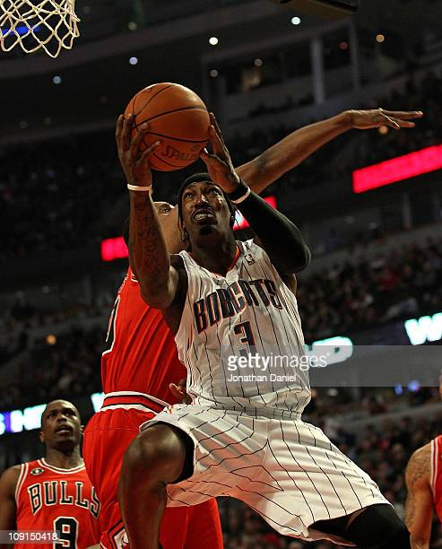 Gerald Wallace of the Charlotte Bobcats goes up for a shot past Kurt Thomas of the Chicago Bulls at the United Center on February 15 2011 in Chicago...
