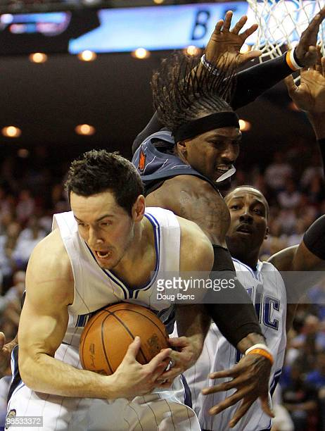 Gerald Wallace of the Charlotte Bobcats has a rebound taken away from him by JJ Redick of the Orlando Magic in Game One of the Eastern Conference...