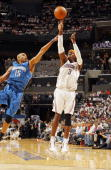 Gerald Wallace of the Charlotte Bobcats shoots over defender Vince Carter of the Orlando Magic in Game Four of the Eastern Conference Quarterfinals...