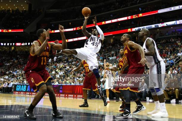 Gerald Wallace of the New Jersey Nets attempts a shot in the second half against Tristan Thompson of the Cleveland Cavaliers at Prudential Center on...