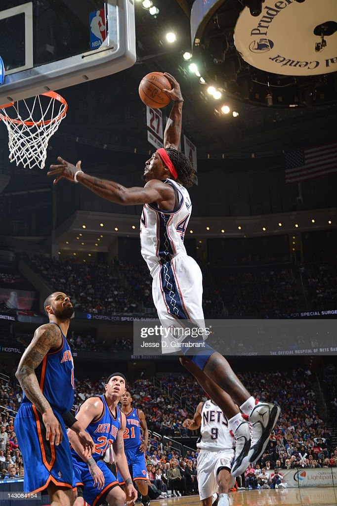 <a gi-track='captionPersonalityLinkClicked' href=/galleries/search?phrase=Gerald+Wallace&family=editorial&specificpeople=202117 ng-click='$event.stopPropagation()'>Gerald Wallace</a> #45 of the New Jersey Nets dunks over <a gi-track='captionPersonalityLinkClicked' href=/galleries/search?phrase=Tyson+Chandler&family=editorial&specificpeople=202061 ng-click='$event.stopPropagation()'>Tyson Chandler</a> #6 of the New York Knicks on April 18, 2012 at the Prudential Center in Newark, New Jersey.