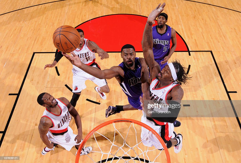 <a gi-track='captionPersonalityLinkClicked' href=/galleries/search?phrase=Gerald+Wallace&family=editorial&specificpeople=202117 ng-click='$event.stopPropagation()'>Gerald Wallace</a> #3 of the Portland Trail Blazers attempts to block the shot of <a gi-track='captionPersonalityLinkClicked' href=/galleries/search?phrase=Tyreke+Evans&family=editorial&specificpeople=4851025 ng-click='$event.stopPropagation()'>Tyreke Evans</a> #13 of the Sacramento Kings during the game on January 23, 2012 at the Rose Garden Arena in Portland, Oregon.