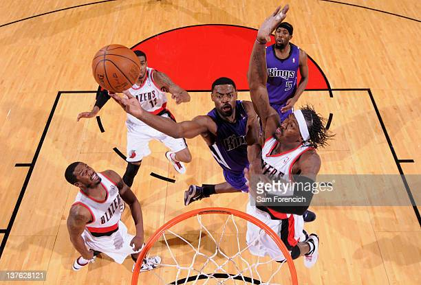Gerald Wallace of the Portland Trail Blazers attempts to block the shot of Tyreke Evans of the Sacramento Kings during the game on January 23 2012 at...