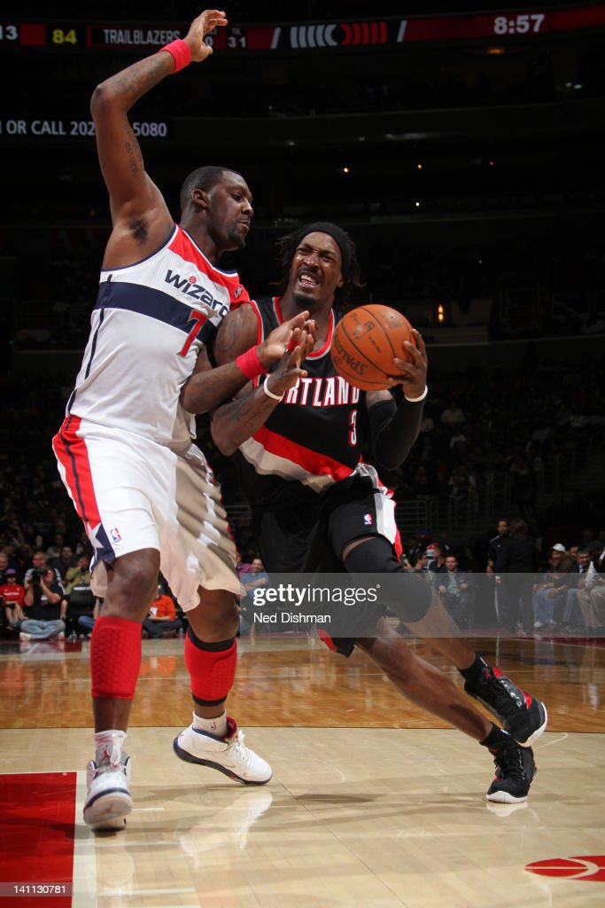 <a gi-track='captionPersonalityLinkClicked' href=/galleries/search?phrase=Gerald+Wallace&family=editorial&specificpeople=202117 ng-click='$event.stopPropagation()'>Gerald Wallace</a> #3 of the Portland Trail Blazers drives against <a gi-track='captionPersonalityLinkClicked' href=/galleries/search?phrase=Andray+Blatche&family=editorial&specificpeople=4282797 ng-click='$event.stopPropagation()'>Andray Blatche</a> #7 of the Washington Wizards at the Verizon Center on March 10, 2012 in Washington, DC.