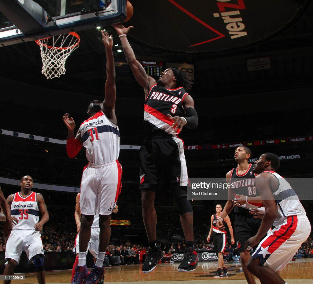 <a gi-track='captionPersonalityLinkClicked' href=/galleries/search?phrase=Gerald+Wallace&family=editorial&specificpeople=202117 ng-click='$event.stopPropagation()'>Gerald Wallace</a> #3 of the Portland Trail Blazers goes to the basket against <a gi-track='captionPersonalityLinkClicked' href=/galleries/search?phrase=Chris+Singleton&family=editorial&specificpeople=241555 ng-click='$event.stopPropagation()'>Chris Singleton</a> #31 of the Washington Wizards at the Verizon Center on March 10, 2012 in Washington, DC.