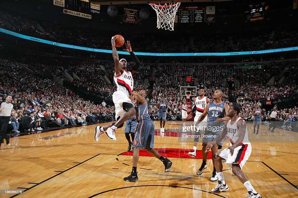<a gi-track='captionPersonalityLinkClicked' href=/galleries/search?phrase=Gerald+Wallace&family=editorial&specificpeople=202117 ng-click='$event.stopPropagation()'>Gerald Wallace</a> #3 of the Portland Trail Blazers goes to the basket against the Charlotte Bobcats on February 1, 2012 at the Rose Garden Arena in Portland, Oregon.
