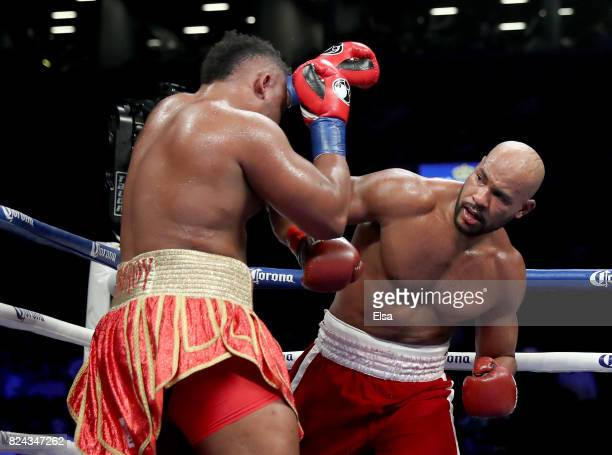 Gerald Washington punches Jarrell Miller during their heavyweight match on July 29 2017 at the Barclays Center in the Brooklyn borough of New York...