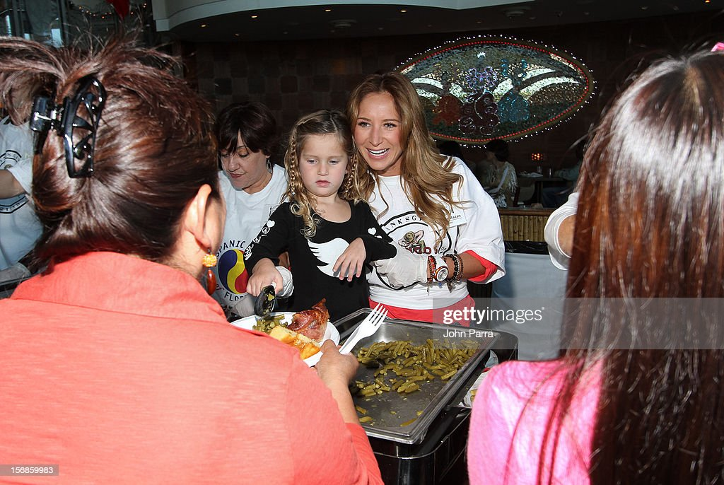 Geraldine Bazan and Elisa Marie participate in 5th Annual Thanksgiving Feed A Friend at Bongos on November 22, 2012 in Miami, Florida.