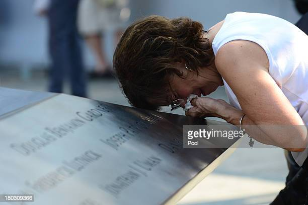 Geraldine Davie of Pelham New York cries after viewing name of her 23yearold daughter Amy O'Doherty during ceremonies for the twelfth anniversary of...