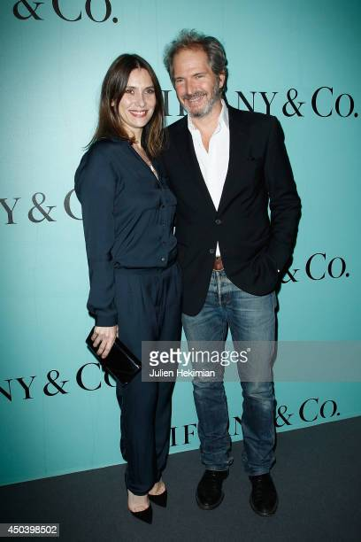 Geraldine Pailhas and Christopher Thompson attend the Tiffany Co Flagship Opening on the Champs Elysee on June 10 2014 in Paris France