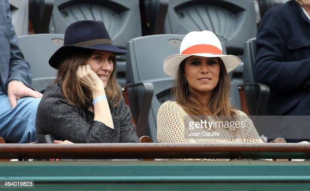 Geraldine Pailhas and Karine Ferri attend the Roland Garros French Tennis Open 2014 Day 2 on May 26 2014 in Paris France