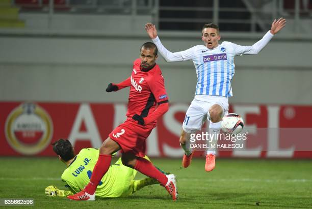 Geraldo Alves of Astra Giurgiu vies for the ball with Timoty Castagne of KRC Genk during the UEFA Europa League round of 32 firstleg football match...
