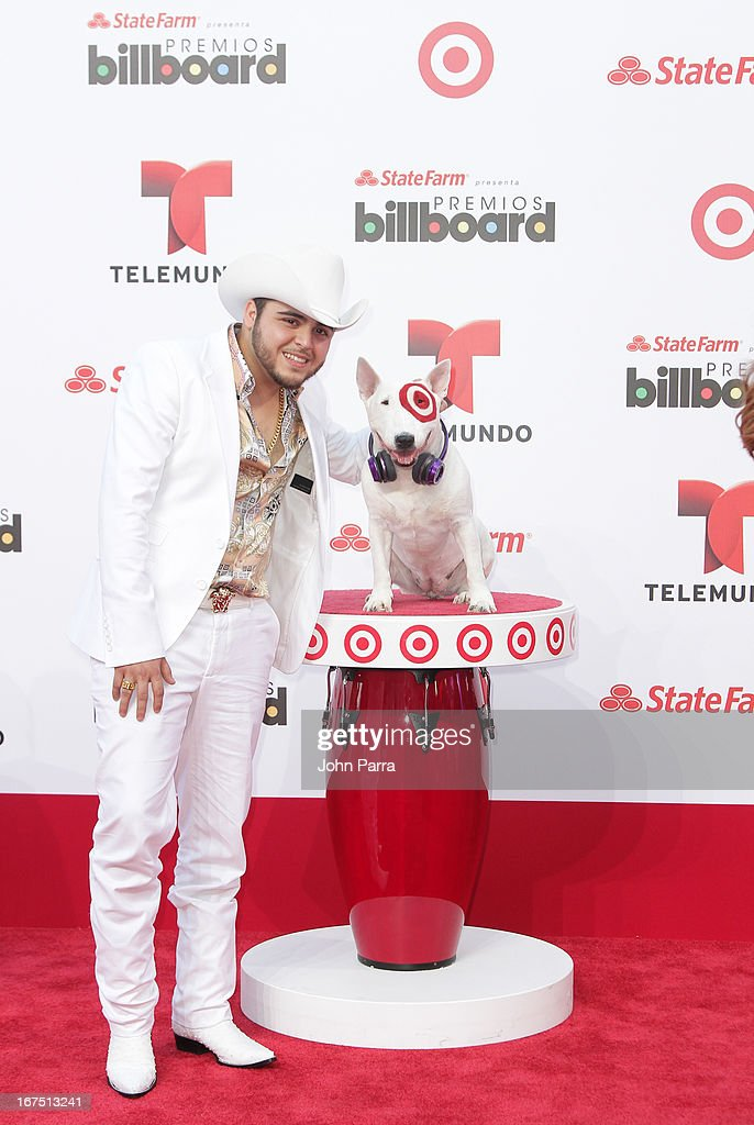 Geraldo Ortiz celebrates with Bullseye, Target's Beloved Bull Terrier Mascot, at the 2013 Billboard Latin Music Awards at BankUnited Center on April 25, 2013 in Miami, Florida.