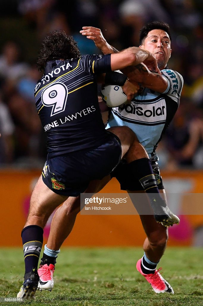 Gerard Beale of the Sharks is tackled by Jake Granville of the Cowboys during the round 24 NRL match between the North Queensland Cowboys and the Cronulla Sharks at 1300SMILES Stadium on August 19, 2017 in Townsville, Australia.