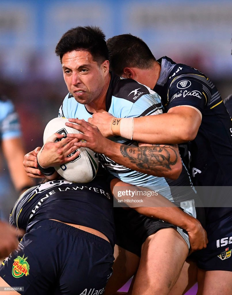 Gerard Beale of the Sharks is tackled during the round 24 NRL match between the North Queensland Cowboys and the Cronulla Sharks at 1300SMILES Stadium on August 19, 2017 in Townsville, Australia.