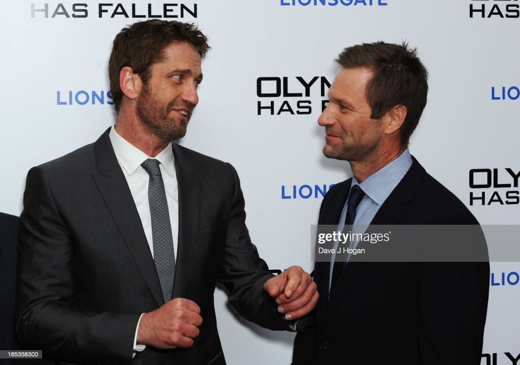 <a gi-track='captionPersonalityLinkClicked' href=/galleries/search?phrase=Gerard+Butler+-+Actor&family=editorial&specificpeople=202258 ng-click='$event.stopPropagation()'>Gerard Butler</a> and <a gi-track='captionPersonalityLinkClicked' href=/galleries/search?phrase=Aaron+Eckhart&family=editorial&specificpeople=220602 ng-click='$event.stopPropagation()'>Aaron Eckhart</a> attend the UK premiere of 'Olympus Has Fallen' at The IMAX on April 03, 2013 in London, England.