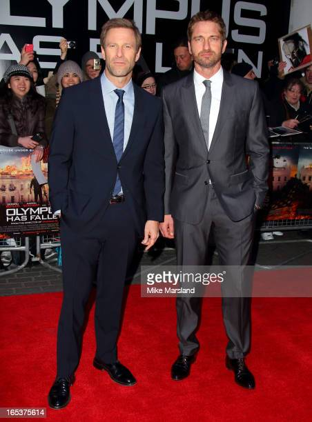 Gerard Butler and Aaron Eckhart attend the UK Premiere of 'Olympus Has Fallen' at BFI IMAX on April 3 2013 in London England