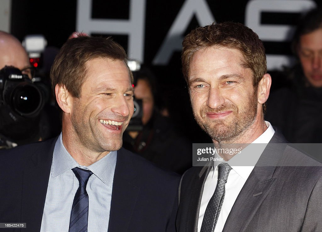 <a gi-track='captionPersonalityLinkClicked' href=/galleries/search?phrase=Gerard+Butler+-+Actor&family=editorial&specificpeople=202258 ng-click='$event.stopPropagation()'>Gerard Butler</a> and <a gi-track='captionPersonalityLinkClicked' href=/galleries/search?phrase=Aaron+Eckhart&family=editorial&specificpeople=220602 ng-click='$event.stopPropagation()'>Aaron Eckhart</a> attend the UK Premiere of 'Olympus Has Fallen' at BFI IMAX on April 3, 2013 in London, England.