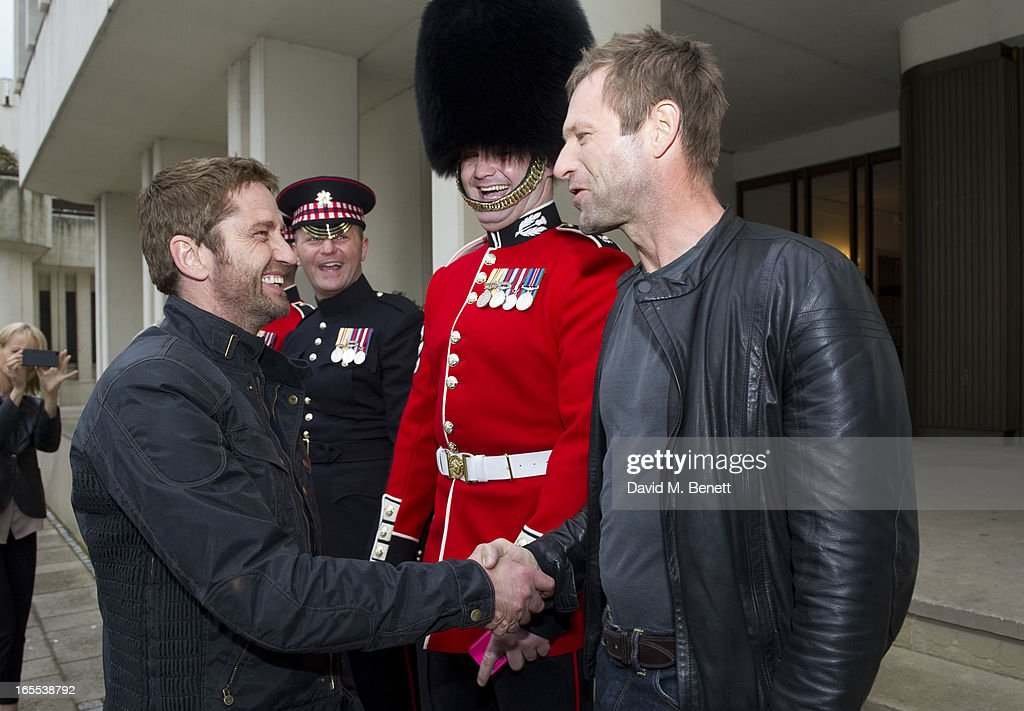 <a gi-track='captionPersonalityLinkClicked' href=/galleries/search?phrase=Gerard+Butler&family=editorial&specificpeople=202258 ng-click='$event.stopPropagation()'>Gerard Butler</a> and Aaron Eckhart pose with troops ahead of a special preview screening of Olympus Has Fallen, released in cinemas on April 17, at Wellington Barracks on April 4, 2013 in London, England.