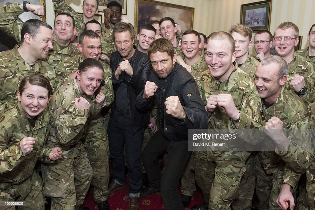 <a gi-track='captionPersonalityLinkClicked' href=/galleries/search?phrase=Gerard+Butler+-+Actor&family=editorial&specificpeople=202258 ng-click='$event.stopPropagation()'>Gerard Butler</a> and Aaron Eckhart pose with troops ahead of a special preview screening of Olympus Has Fallen, released in cinemas on April 17, at Wellington Barracks on April 4, 2013 in London, England.