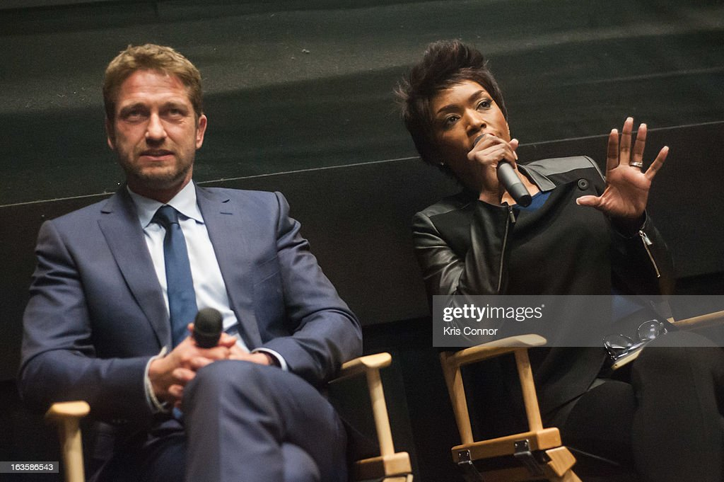 Gerard Butler and Angela Bassett Picture speak during the 'Olympus Has Fallen' screening at AMC Loews Georgetown 14 on March 12, 2013 in Washington, DC.
