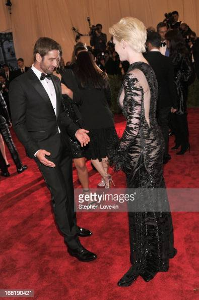 Gerard Butler and Anne Hathaway attend the Costume Institute Gala for the 'PUNK Chaos to Couture' exhibition at the Metropolitan Museum of Art on May...
