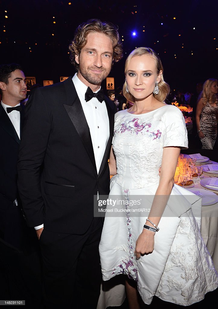 Gerard Butler and Diane Kruger attend the 2012 amfAR's Cinema Against AIDS during the 65th Annual Cannes Film Festival at Hotel Du Cap on May 24 2012...