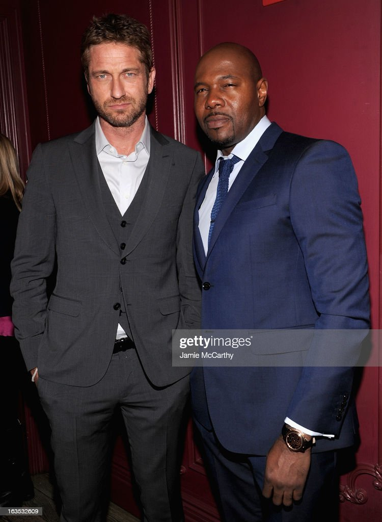 Gerard Butler and director Antoine Fuqua attend the after party for The Cinema Society with Roger Dubuis and Grey Goose screening of FilmDistrict's 'Olympus Has Fallen' at The Darby on March 11, 2013 in New York City.