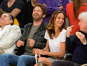Gerard Butler and guest attend a basketball game between the Houston Rockets and the Los Angeles Lakers at Staples Center on October 28 2014 in Los...
