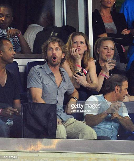 Gerard Butler and guest attend the 2011 MLS AllStars vs Manchester United game at Red Bull Arena on July 27 2011 in Harrison New Jersey