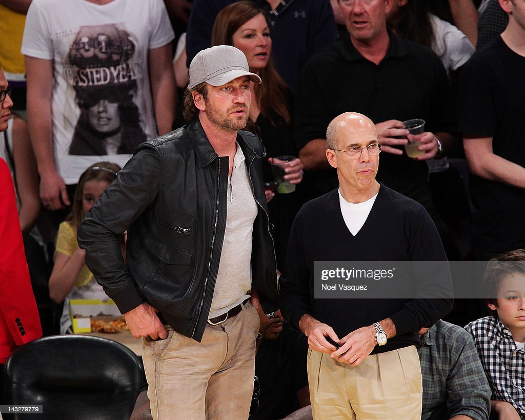 Gerard Butler (L) and Jeffrey Katzenberg attend a basketball game between the Oklahoma City Thunder and the Los Angeles Lakers at Staples Center on April 22, 2012 in Los Angeles, California.