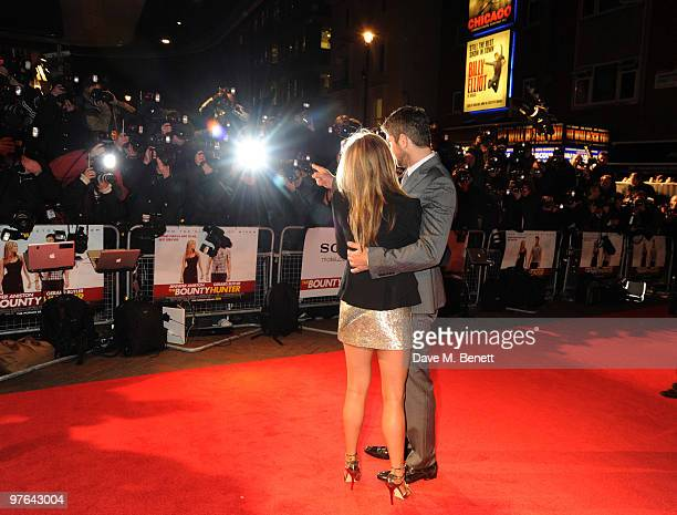 Gerard Butler and Jennifer Aniston arrive at the UK film premiere of 'The Bounty Hunter' at the Vue West End Cinema on March 11 2010 in London England