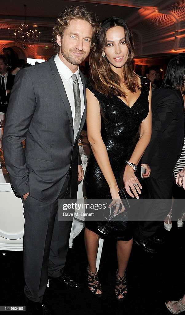<a gi-track='captionPersonalityLinkClicked' href=/galleries/search?phrase=Gerard+Butler&family=editorial&specificpeople=202258 ng-click='$event.stopPropagation()'>Gerard Butler</a> (L) and Madalina Ghenea attend the IWC and Finch's Quarterly Review Annual Filmmakers Dinner at Hotel Du Cap-Eden Roc on May 21, 2012 in Antibes, France.