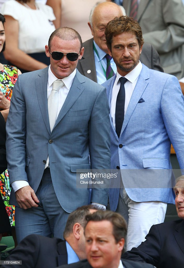Gerard Butler and Wayne Rooney attend the Gentlemen's Singles Final match between Andy Murray of Great Britain and Novak Djokovic of Serbia on day thirteen of the Wimbledon Lawn Tennis Championships at the All England Lawn Tennis and Croquet Club on July 7, 2013 in London, England.
