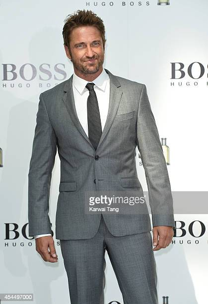 Gerard Butler attends a photocall where he is announced as the new brand ambassador for BOSS and BOSS BOTTLED at Westfield London on September 2 2014...
