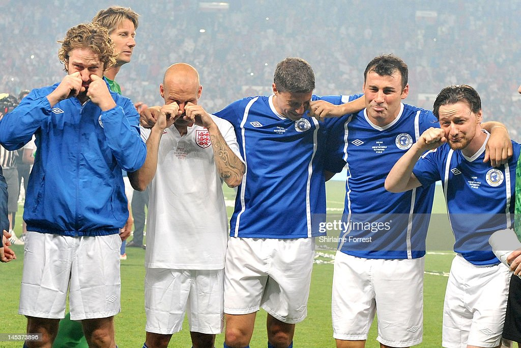 Gerard Butler, Freddie Ljunberg, Hernan Crespo, Joe Calzaghe and James McAvoy of the Rest Of The World team pretend to cry after loosing in charity football event Soccer Aid 2012 to raise funds for UNICEF on May 27, 2012 in Manchester, United Kingdom.