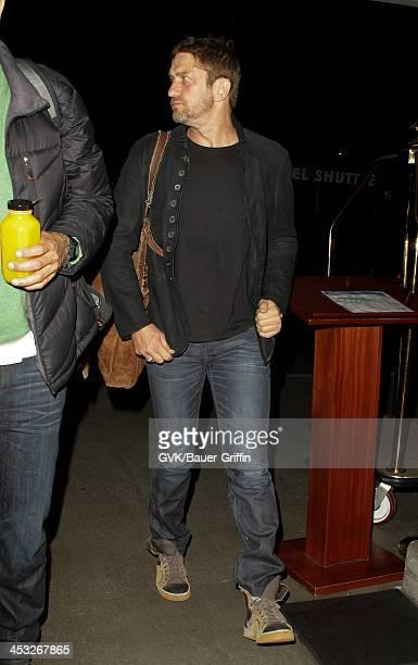 Gerard Butler is seen arriving at Los Angeles International airport on December 02 2013 in Los Angeles California