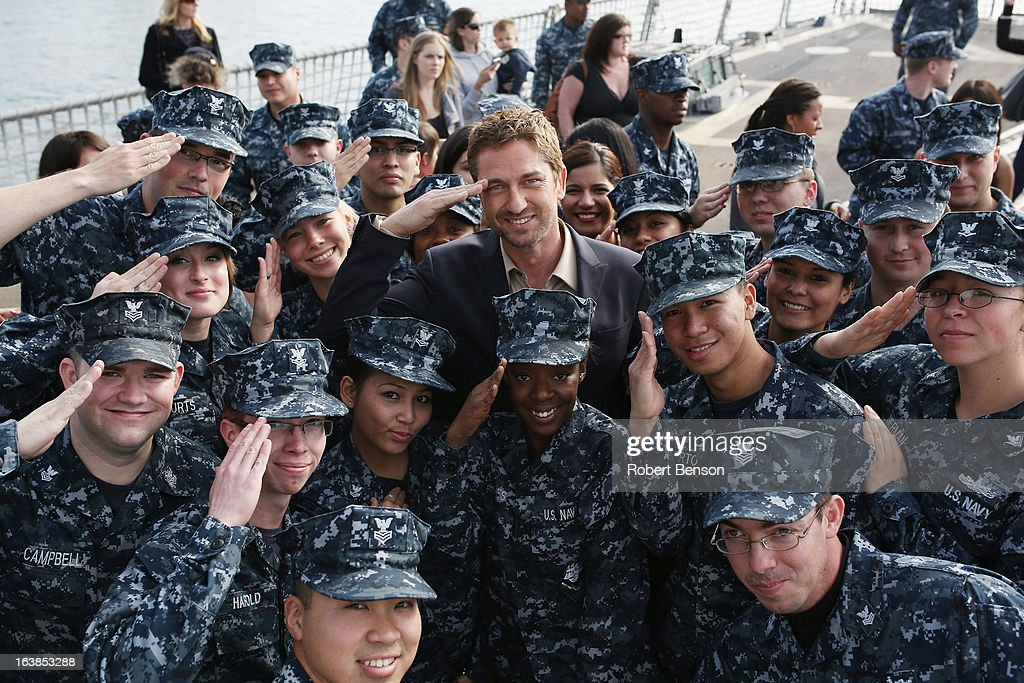 <a gi-track='captionPersonalityLinkClicked' href=/galleries/search?phrase=Gerard+Butler&family=editorial&specificpeople=202258 ng-click='$event.stopPropagation()'>Gerard Butler</a> poses with Navy sailors during a visit to Naval Base San Diego where the movie 'Olympus Has Fallen' was previewed to military members on March 16, 2013 in San Diego, California.