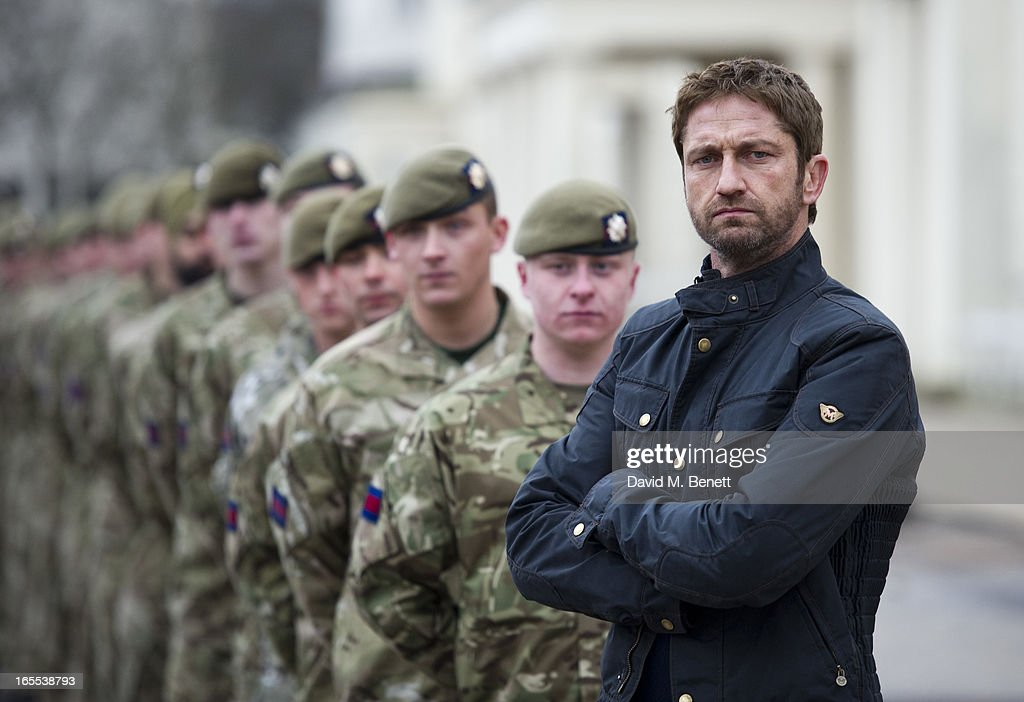 <a gi-track='captionPersonalityLinkClicked' href=/galleries/search?phrase=Gerard+Butler&family=editorial&specificpeople=202258 ng-click='$event.stopPropagation()'>Gerard Butler</a> poses with troops ahead of a special preview screening of Olympus Has Fallen, released in cinemas on April 17, at Wellington Barracks on April 4, 2013 in London, England.