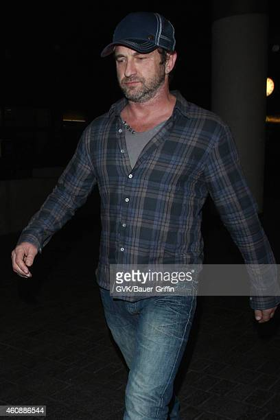 Gerard Butler seen at LAX on December 28 2014 in Los Angeles California