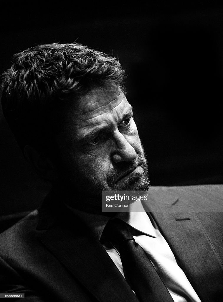 <a gi-track='captionPersonalityLinkClicked' href=/galleries/search?phrase=Gerard+Butler&family=editorial&specificpeople=202258 ng-click='$event.stopPropagation()'>Gerard Butler</a> speaks during the 'Olympus Has Fallen' screening at AMC Loews Georgetown 14 on March 12, 2013 in Washington, DC.