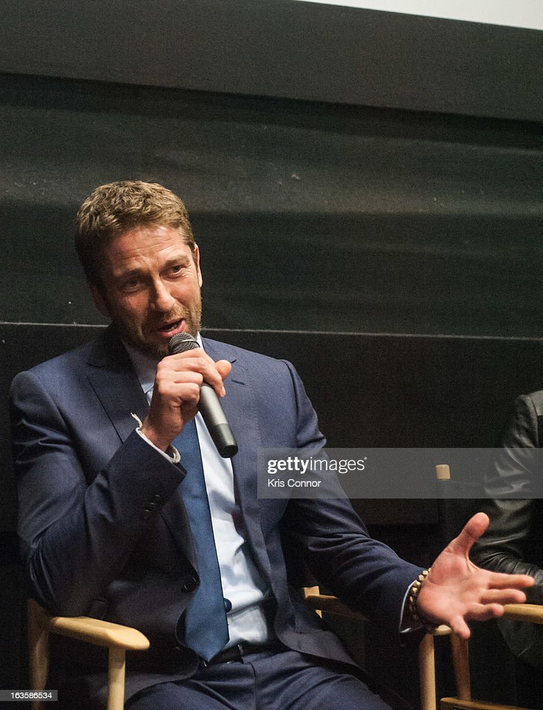 <a gi-track='captionPersonalityLinkClicked' href=/galleries/search?phrase=Gerard+Butler+-+Actor&family=editorial&specificpeople=202258 ng-click='$event.stopPropagation()'>Gerard Butler</a> speaks during the 'Olympus Has Fallen' screening at AMC Loews Georgetown 14 on March 12, 2013 in Washington, DC.