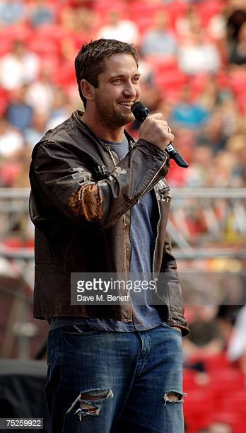 Gerard Butler talks on stage during the Live Earth London concert at Wembley Stadium on July 7 2007 in London England Live Earth is a 24hour...