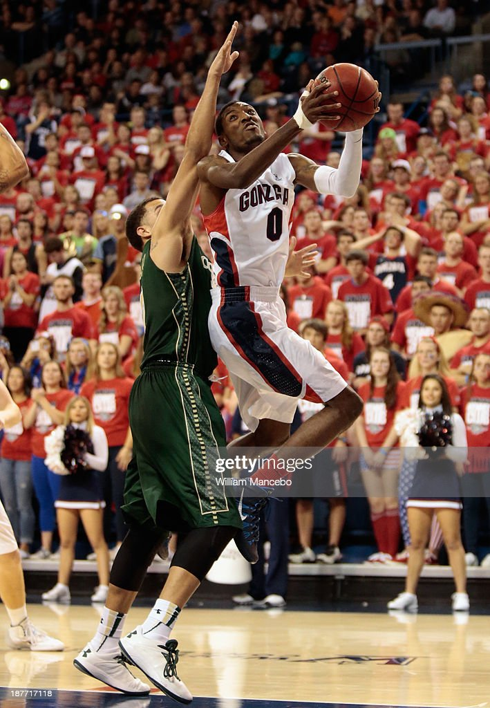 Gerard Coleman #0 of the Gonzaga Bulldogs goes to the hoop against Marcus Holt #3 of the Colorado State Rams during the game at McCarthey Athletic Center on November 11, 2013 in Spokane, Washington.
